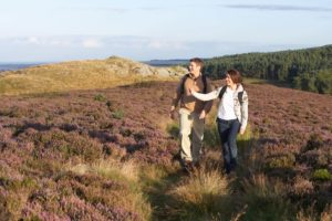 Couple Hiking Moorland Local Area Cornwall
